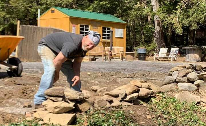 Troy builds the rock walls at Balthazar's Ice Shack